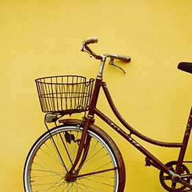 Bicycle against a yellow wall