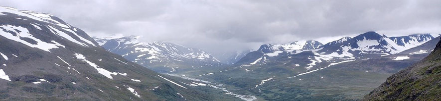 Panoramic photo of snowy mountains.